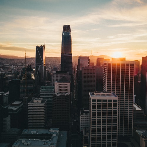 sunset behind San Francisco city skyline